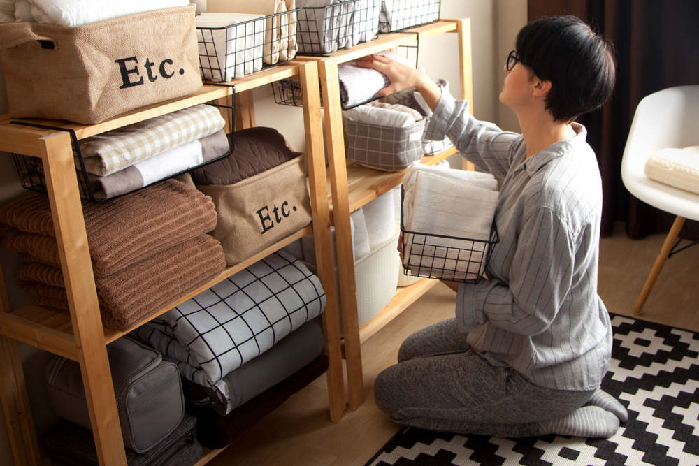 Man decluttering his belongings (6 Tips on How to Declutter Your Apartment)