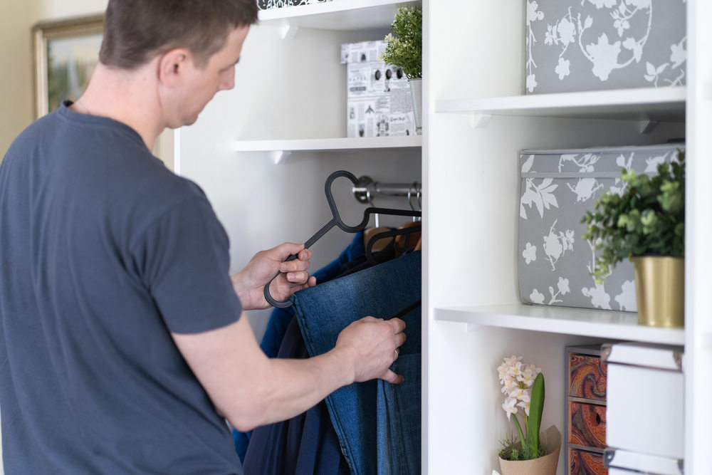 Man organizing with vertical space